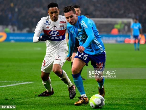 Marseille's French forward Florian Thauvin fights for the ball with Lyon's Dutch defender Kenny Tete during the French L1 football match Olympique...