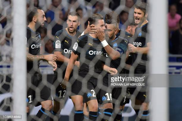 Marseille's French forward Florian Thauvin is congratulated by French midfielder Dimitri Payet as he celebrates with team mates after scoring a goal...