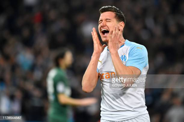 Marseille's French forward Florian Thauvin reacts after missing a goal opportunity during the French L1 football match between Olympique de Marseille...