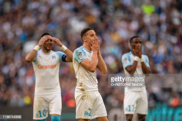Marseille's French forward Florian Thauvin reacts after missing an opportunity to score a goal during the French L1 football match between Marseille...