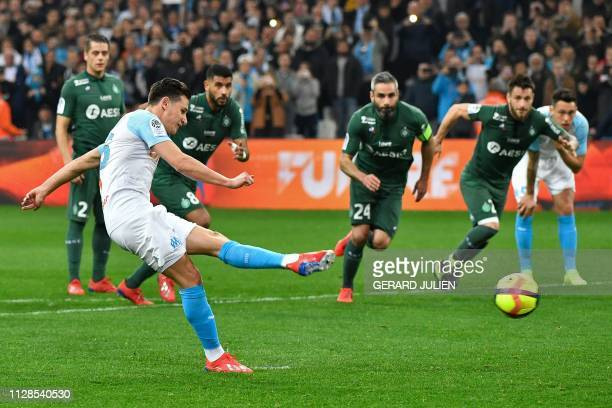 Marseille's French forward Florian Thauvin scores on a penalty kick during the French L1 football match between Olympique de Marseille and AS...