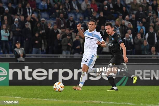 Marseille's French forward Florian Thauvin shoots to score despite Lazio's Brazilian defender Luiz Felipe during the UEFA Europa League group H...