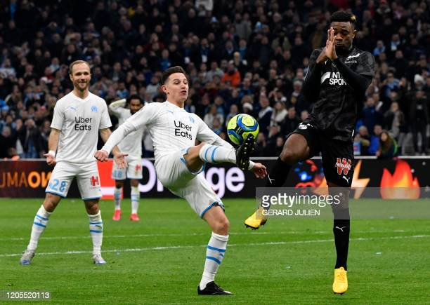 TOPSHOT Marseille's French forward Florian Thauvin vies with Amiens' Cameroonian defender Aurelien Chedjou during the French L1 football match...