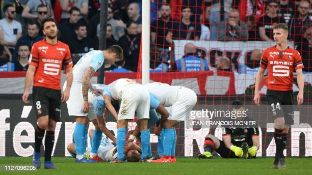 Marseille's French forward Valere Germain is congratulated after scoring with head during the French L1 Football match between Rennes and Marseille ,...