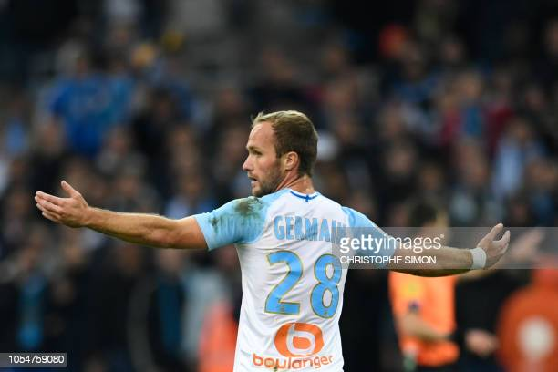 Marseille's French forward Valere Germain reacts during the French L1 football match between Olympique de Marseille and Paris SaintGermain at the...