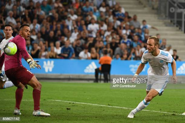 TOPSHOT Marseille's French forward Valere Germain scores a goal past Domzale's Slovenian goalkeeper Dejan Milic during the UEFA Europa League playoff...