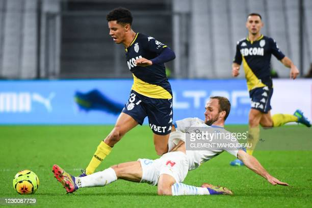 Marseille's French forward Valere Germain tackles Monaco's French midfielder Sofiane Diop during the French L1 football match between Olympique de...