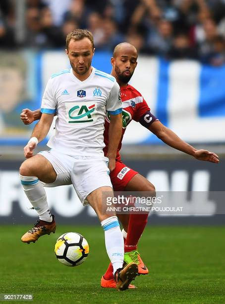 Marseille's French forward Valere Germain vies for the ball with Valenciennes's midfielder Lenny Nangis during the French Cup football match between...