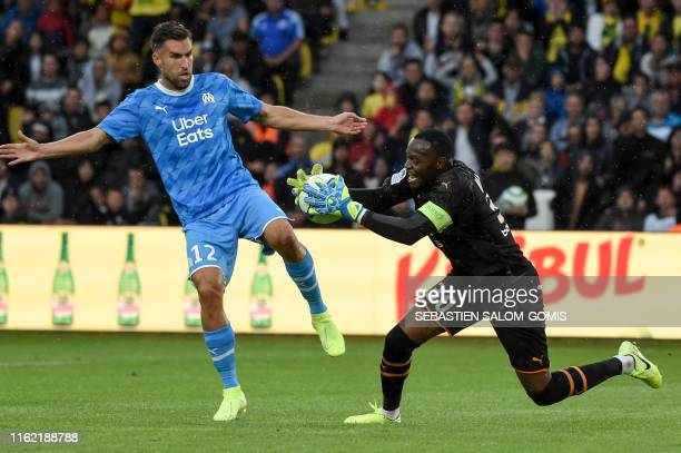 Marseille's French goalkeeper Steve Mandanda catches the ball during the French L1 football match between Nantes and Olympique de Marseille at the La...