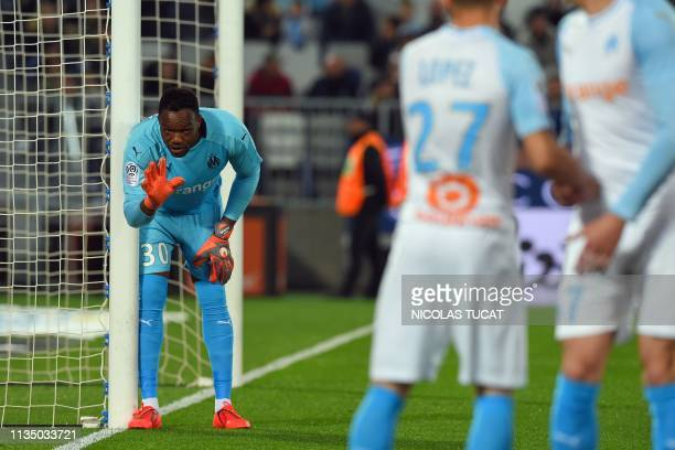 Marseille's French goalkeeper Steve Mandanda gestures during the French L1 football match between Bordeaux and Marseille on April 5 2019 at the...