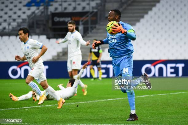Marseille's French goalkeeper Steve Mandanda makes a save during the French L1 football match between Olympique de Marseille and AS Monaco at the...