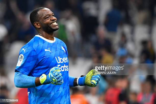 Marseille's French goalkeeper Steve Mandanda reacts during the French L1 football match between Olympique de Marseille and Stade Rennais Football...