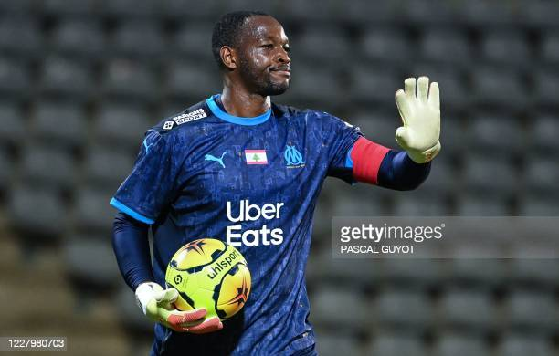 Marseille's French goalkeeper Steve Mandanda reacts during the French friendly football match between Nimes Olympique and Olympique de Marseille at...