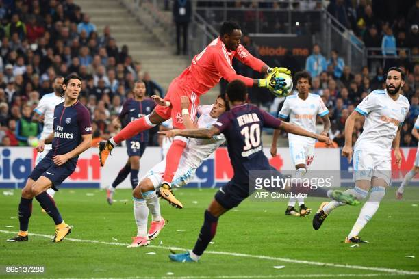 Marseille's French goalkeeper Steve Mandanda saves the ball during the French L1 football match between Marseille and Paris SaintGermain on October...