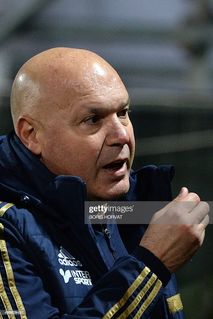 Marseille's French head coach Jose Anigo reacts at the end of the French L1 football match Olympique de Marseille vs Toulouse at the Velodrome stadium in Marseille, on February 2, 2014.