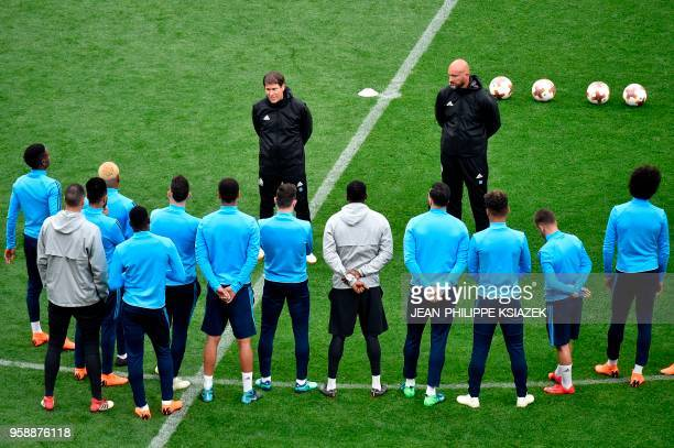 Marseille's French head coach Rudi Garcia speaks to his players during a training session at the Parc OL stadium in Decines-Charpieu on May 15 on the...