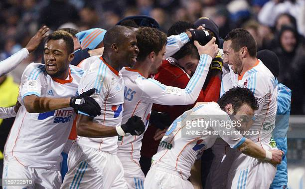 Marseille's French midfielder Andre Pierre Gignac is congratulated by his teammates after scoring a goal during the French L1 football match...