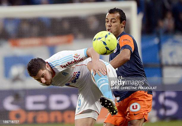 Marseille's French midfielder Andre Pierre Gignac vies for the ball with Montpellier's Brazilian defender Vitorino Hilton on January 19 at the...