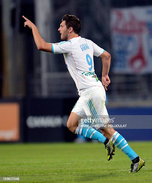 Marseille's French midfielder AndrePierre Gignac celebrates after scoring during the French L1 football match Olympique de Marseille vs Paris...