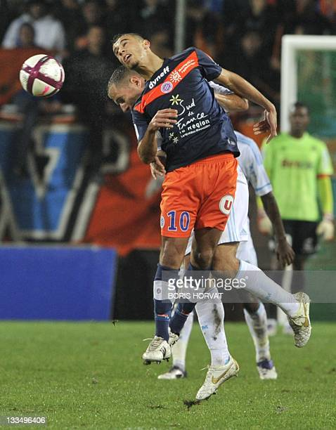 Marseille's French midfielder Benoit Cheyrou fights for the ball with Montpellier's French midfielder Younes Belhanda during the French L1 football...