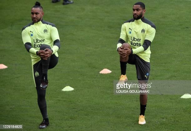 Marseille's French midfielder Dimitri Payet and Marseille's French defender Jordan Amavi warm up during a training session at the Karaiskaki stadium...