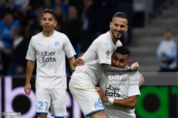 Marseille's French midfielder Dimitri Payet celebrates with Marseille's Argentine forward Dario Benedetto after scoring a goal during the French L1...