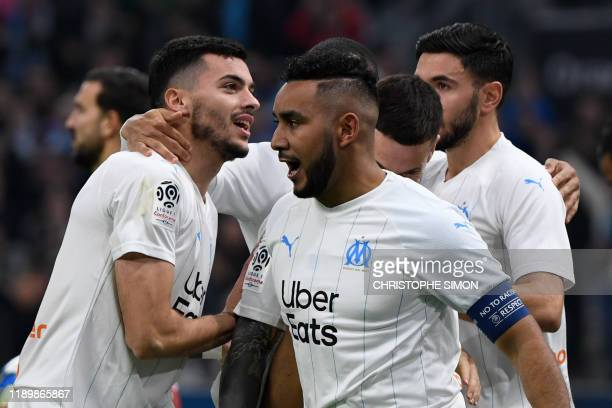Marseille's French midfielder Dimitri Payet celebrates with team mates after scoring a goal during the French L1 football match between Olympique de...