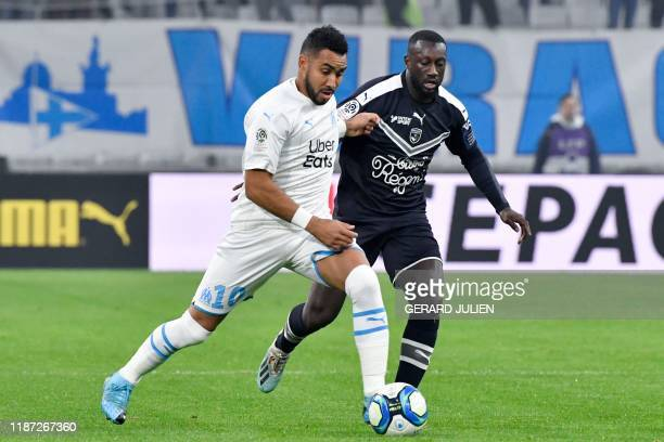 Marseille's French midfielder Dimitri Payet fights for the ball with Bordeaux's Senegalese defender Youssouf Sabaly during the French L1 football...