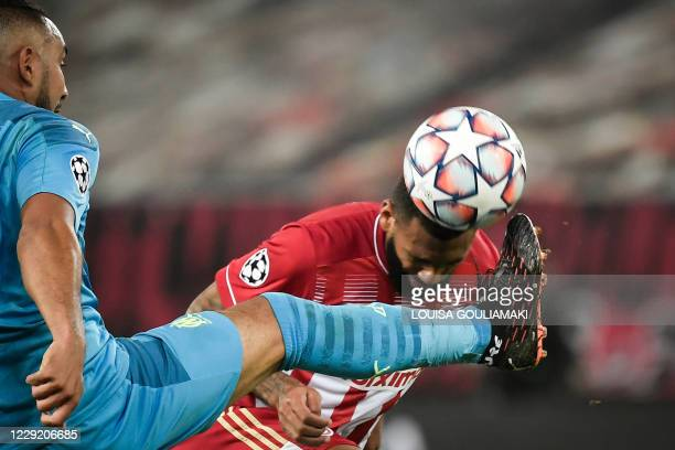 Marseille's French midfielder Dimitri Payet fights for the ball with Olympiakos' French midfielder Yann Mvila during the UEFA Champions League Group...