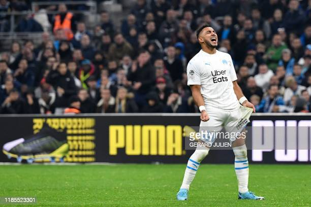 Marseille's French midfielder Dimitri Payet reacts after missing a goal opportunity during the French L1 football match between Olympique de...