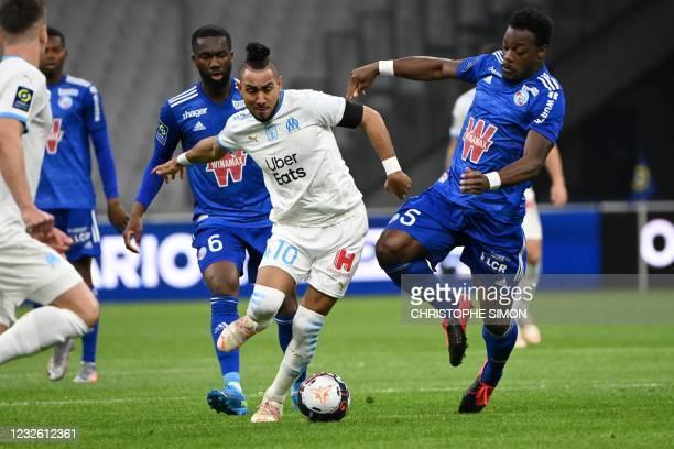 Marseille's French midfielder Dimitri Payet vies with Strasbourg's Ivorian defender Lamine Kone during the French L1 football match between Marseille...