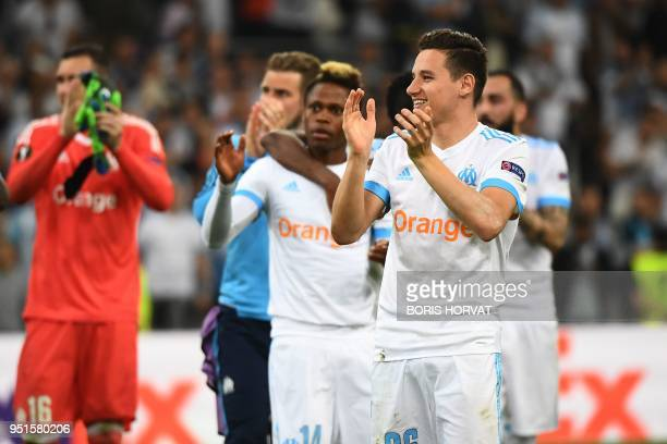 Marseille's French midfielder Florian Thauvin and team mates celebrate their victory at the end of the UEFA Europa League firstleg semifinal football...