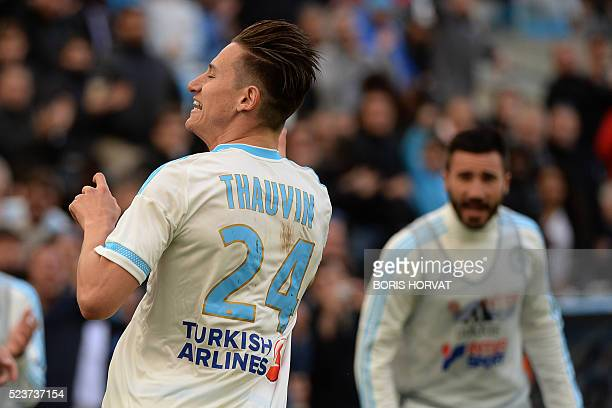 Marseille's French midfielder Florian Thauvin celebrates after scoring an equalizer during the French L1 football match between Marseille and Nantes...
