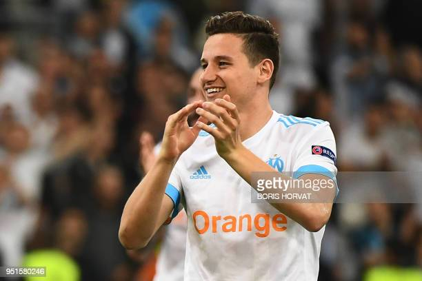 Marseille's French midfielder Florian Thauvin celebrates their victory at the end of the UEFA Europa League firstleg semifinal football match between...