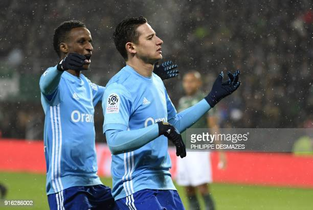 Marseille's French midfielder Florian Thauvin celebrates with Marseille's French forward Bouna Sarr after scoring a goal during the French L1...
