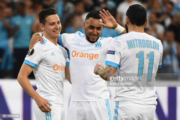 TOPSHOT Marseille's French midfielder Florian Thauvin celebrates with Marseille's French forward Dimitri Payet and Marseille's Greek forward...