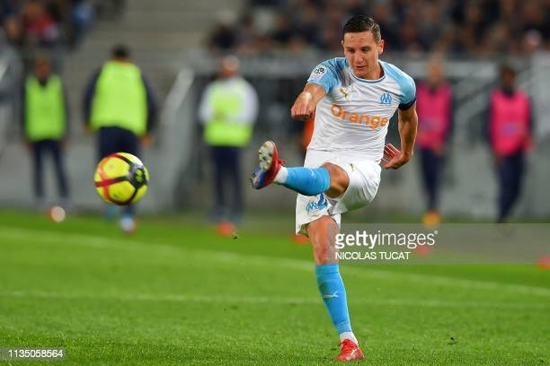 Marseille's French midfielder Florian Thauvin kicks the ball during the French Ligue 1 football match between FC Girondins de Bordeaux and Olympique...