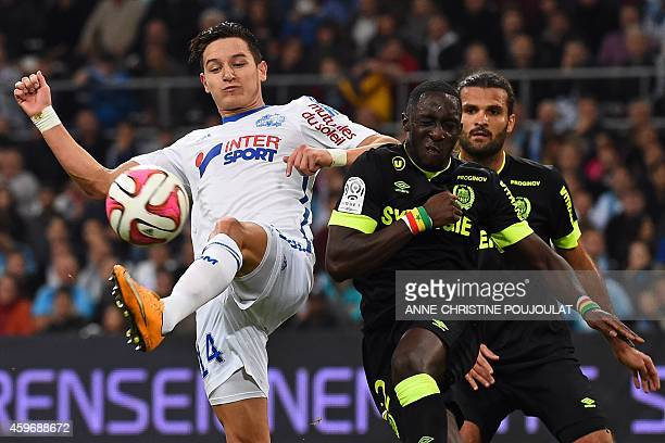 Marseille's French midfielder Florian Thauvin shoots past Nantes' French defender Issa Cissokho to open the scoring during the French L1 football...