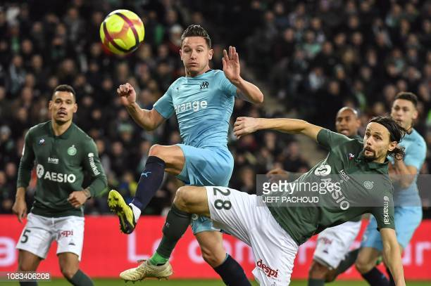 Marseille's French midfielder Florian Thauvin tries to score as he is defended by Saint-Etienne's Serbian defender Neven Subotic during the French L1...