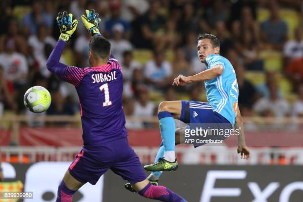 Marseille's French midfielder Florian Thauvin vies for the ball with Monaco's Croatian goalkeeper Danijel Subasic during the French L1 football match...