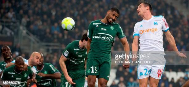 Marseille's French midfielder Florian Thauvin vies with SaintEtienne' Swiss defencer Sandy Janko during the French L1 football match Olympique de...