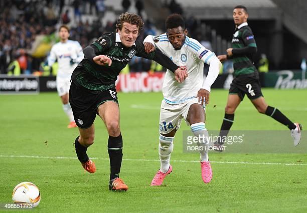 Marseille's French midfielder GeorgesKevin Nkoudou vies for the ball with Groningen's Dutch defender Etienne Reijnen during a UEFA Europa League...