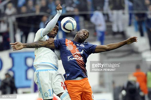 Marseille's French midfielder Georges-Kévin Nkoudou vies with Montpelliers French midfielder Bryan Dabo during the French L1 football match Olympique...