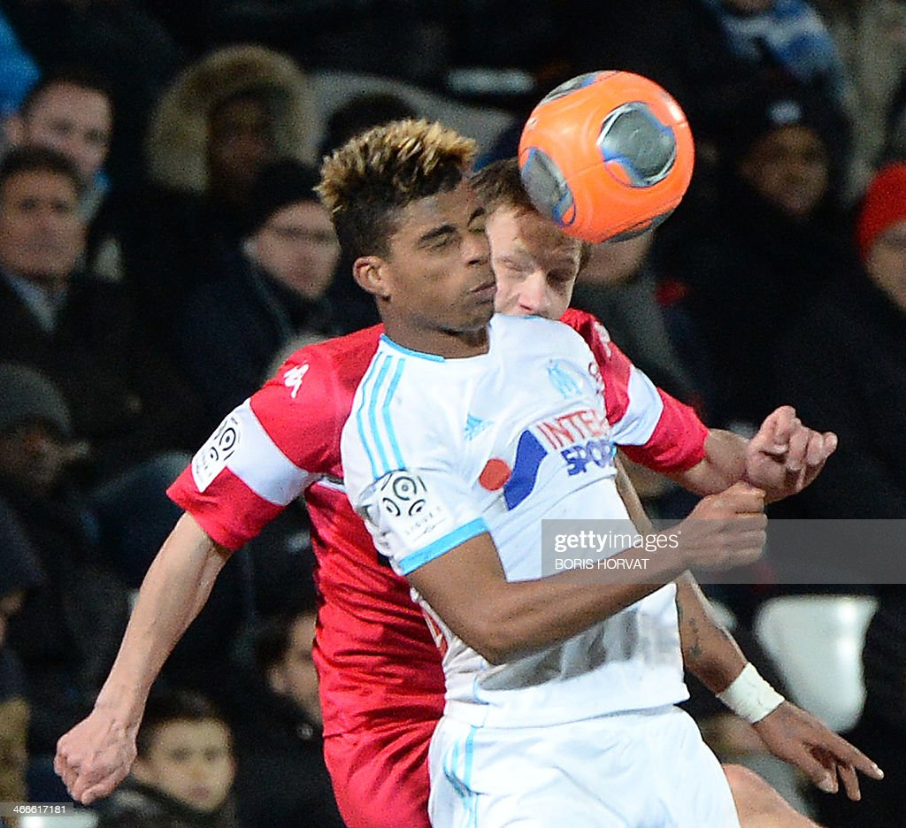 Marseille's French midfielder Mario Lemina (Front) vies with Toulouse's French midfielder Clement Chantome during the French L1 football match Olympique de Marseille vs Toulouse at the Velodrome stadium in Marseille, on February 2, 2014.
