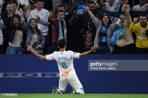 Marseille's French midfielder Morgan Sanson celebrates after scoring a goal during the French L1 football match between Olympique de Marseille and...