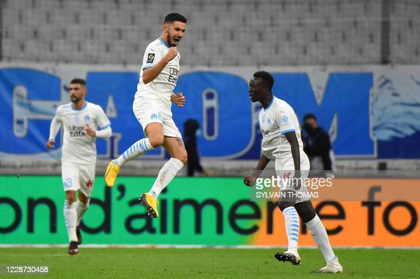 Marseille's French midfielder Morgan Sanson celebrates after scoring a goal during the French L1 football match between Olympique de Marseille and FC...