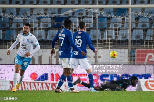 Marseille's French midfielder Morgan Sanson celebrates after scoring a goal during the French L1 football match between Strasbourg and Marseille on...
