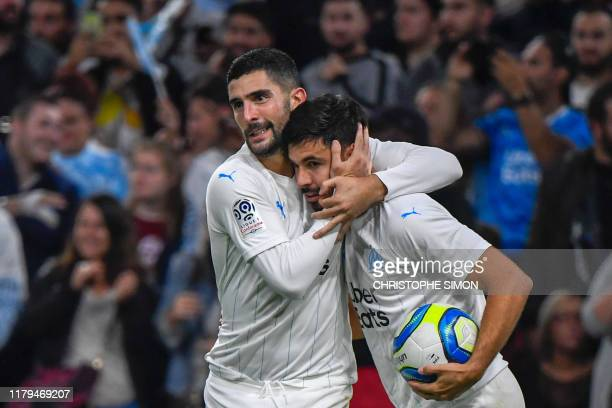 Marseille's French midfielder Morgan Sanson celebrates with Marseille's Spanish defender Alvaro Gonzalez after scoring a goal during the French L1...