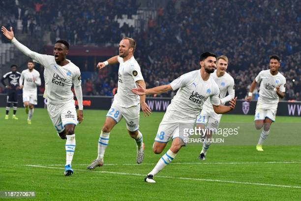 Marseille's French midfielder Morgan Sanson celebrates with teammates after scoring a goal during the French L1 football match between Olympique de...