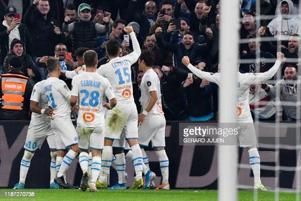 TOPSHOT Marseille's French midfielder Morgan Sanson celebrates with teammates after scoring a goal during the French L1 football match between...